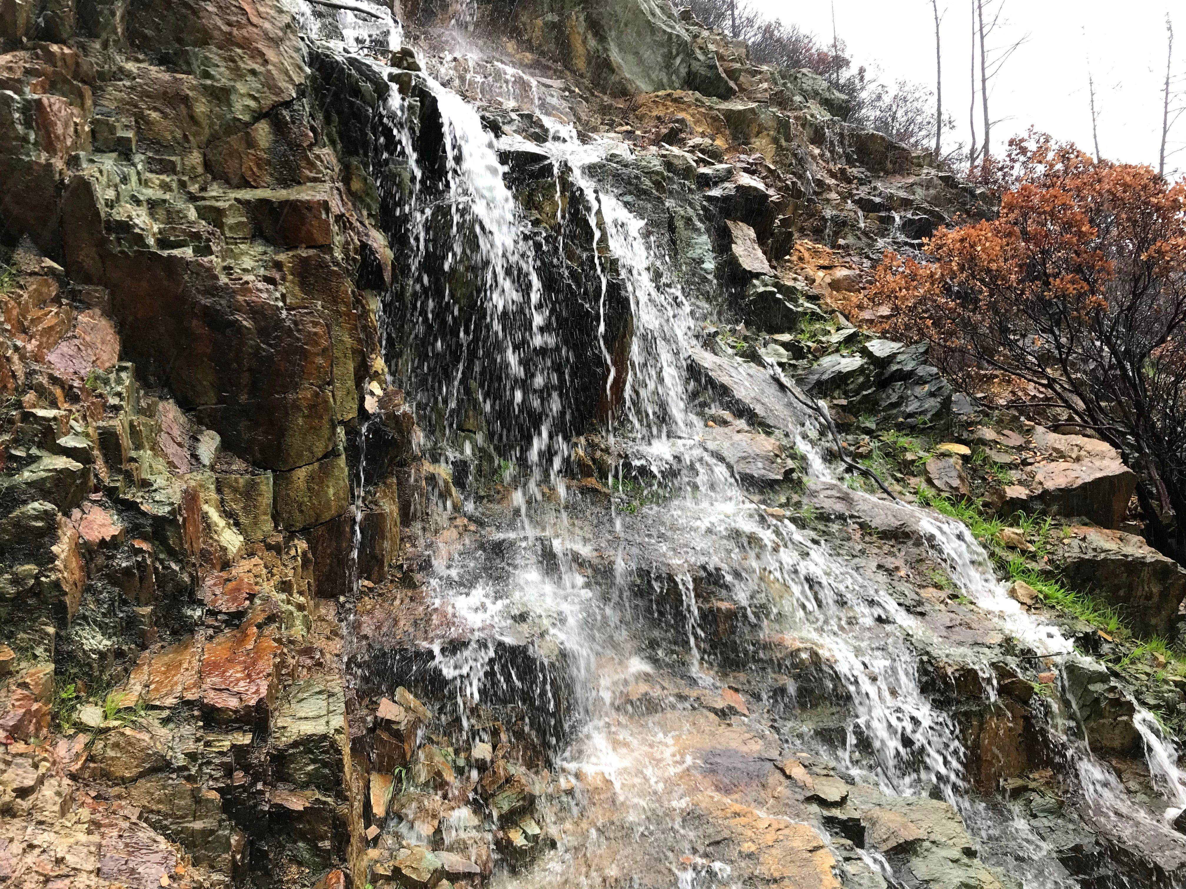 Water cascades down a hillside near Whiskeytown Lake on Tuesday.