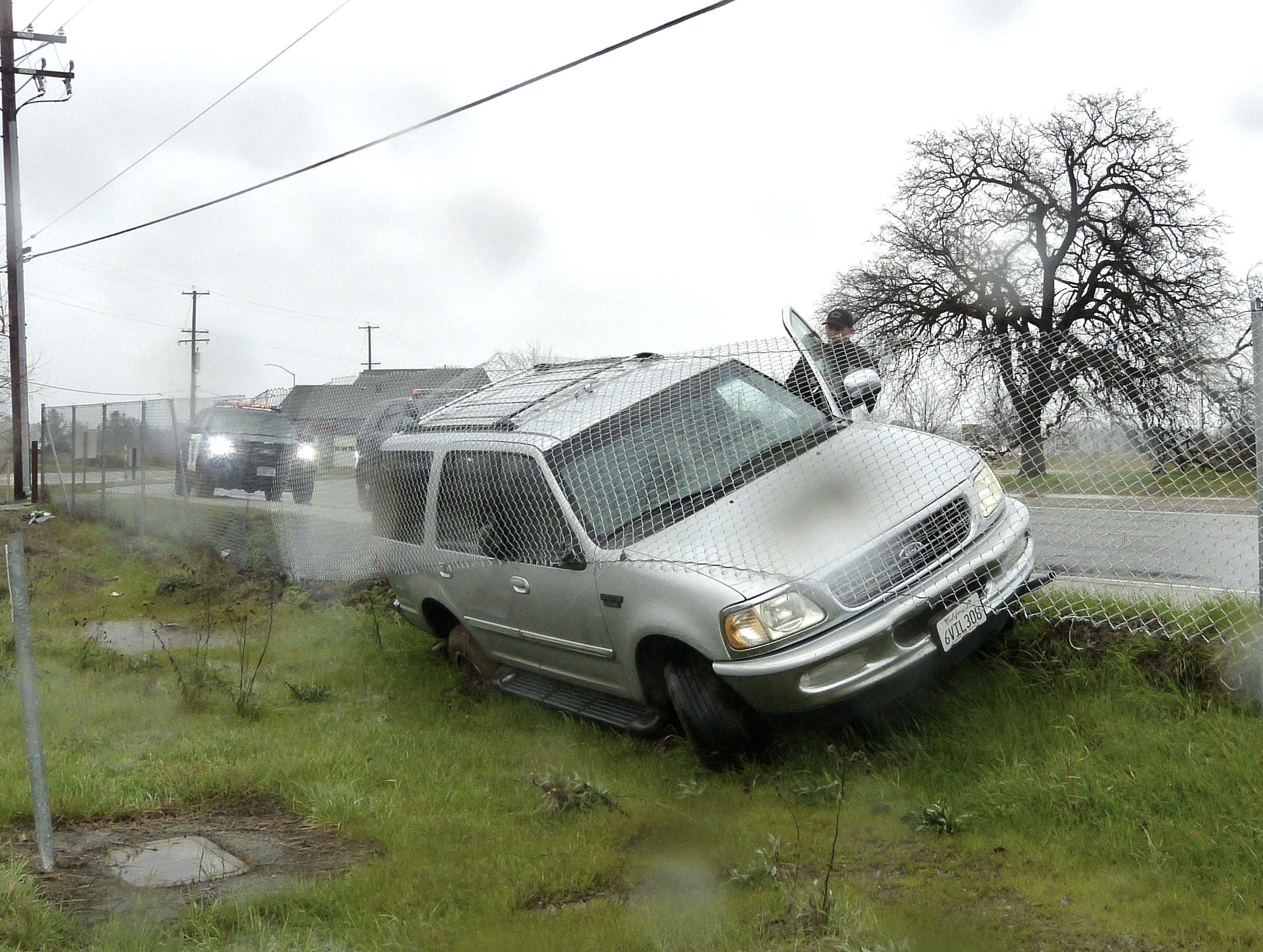 Redding police investigate after a car went off Hilltop Drive during the rain on Tuesday.