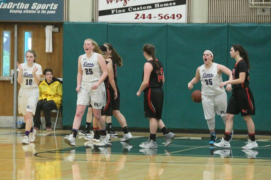 Redding Christian's Sadie Alexander (10), Sammie Wunner (25) and Kaylee Jones (35) react after scoring during the Lions' 41-37 overtime win vs. Etna in the girls Division VI Northern Section championship game at Shasta College on Saturday, Feb. 23.