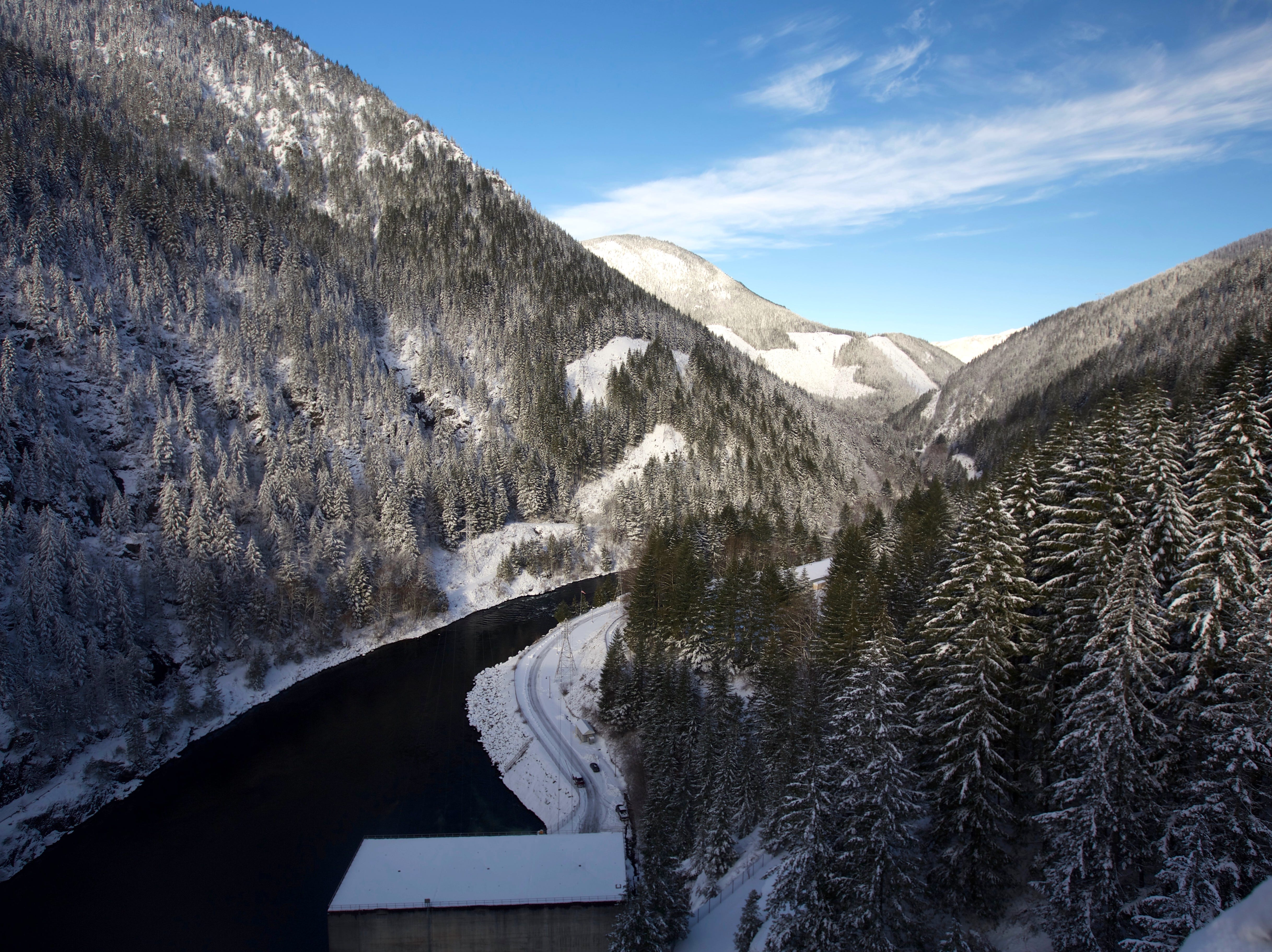 View into the North Santiam River covered in snow from Detroit Dam.