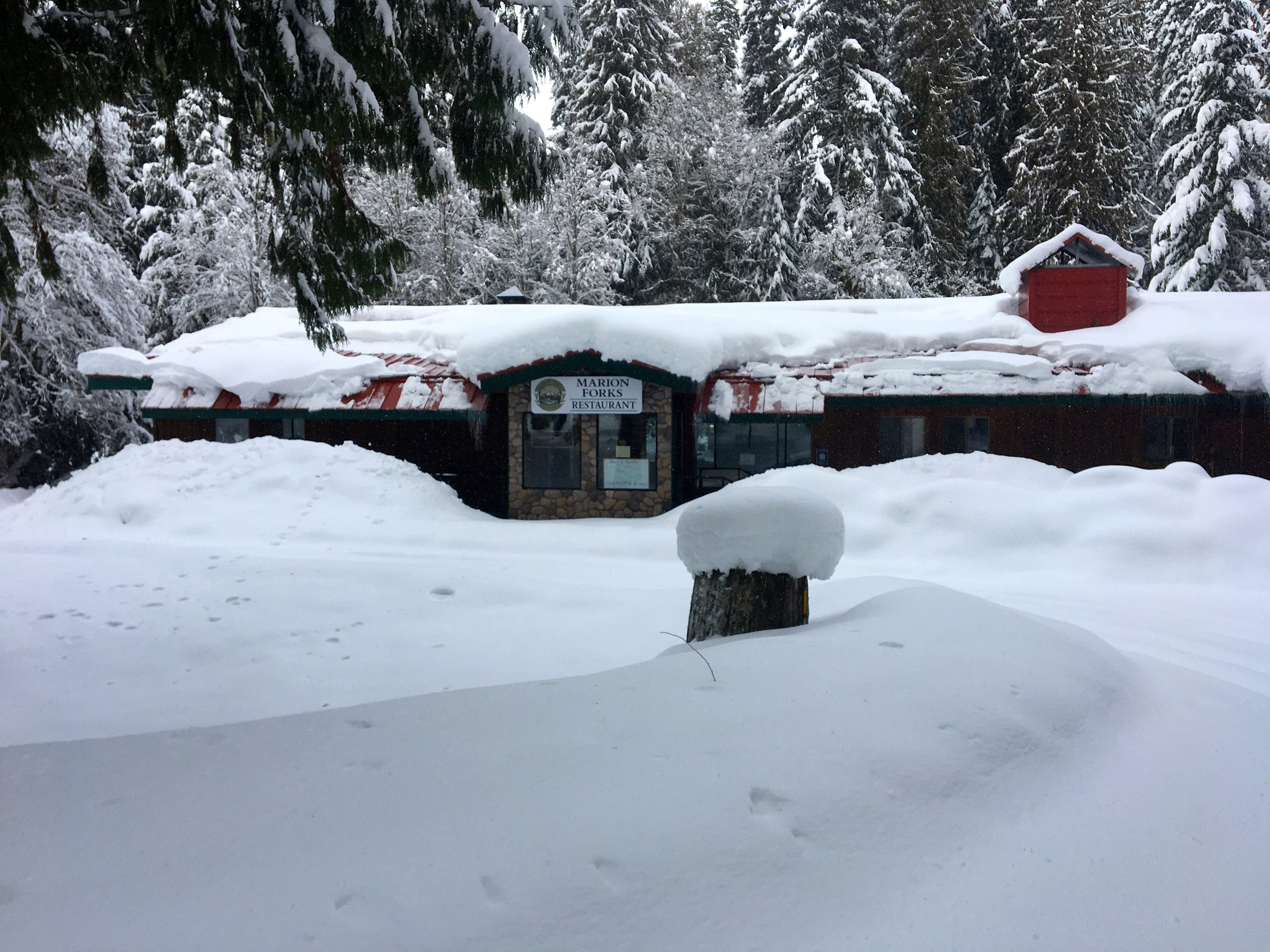 Marion Forks Restaurant, now closed, blanketed in snow.