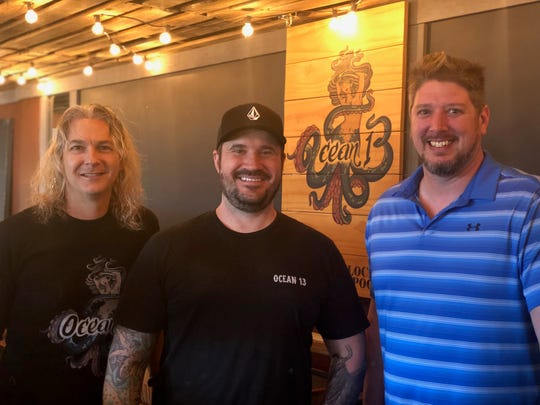 Co-owners Steve Bowers (left), Jeremy Brink (center) and Nicholas Sikora (right) stand for a photo in the new Ocean 13 coffee shop. Photo courtesy of Nicole Hills.