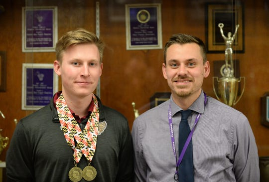 Crisfield High School track runner Kyle Noll (left) and head coach Brandon Austin pose for a picture following Noll's pair of state championships.