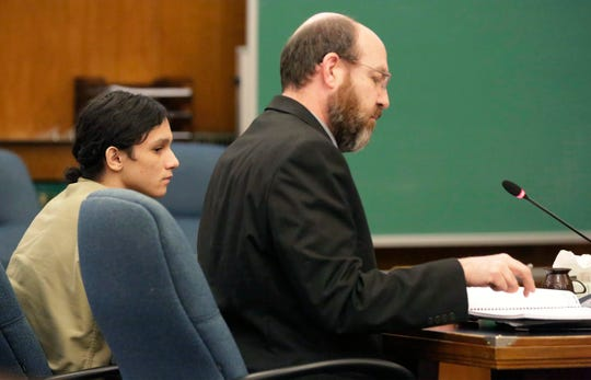 Romeo Alexis Torres, left, sits next to his attorney in Sheboygan County Circuit Court Branch 1, Tuesday, February 26, 2019, in Sheboygan, Wis. Torres, 16, was charged with being party to hiding a corpse.