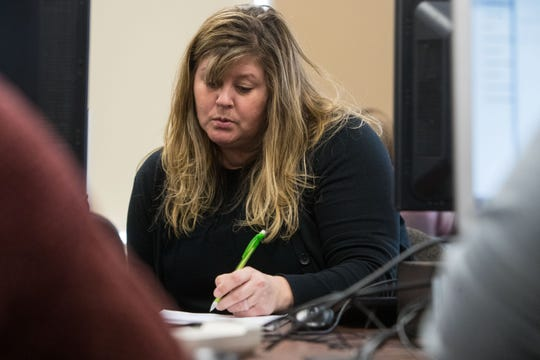 Angela Keith, Math 095 teacher, helps a student in class, Tuesday, Feb. 26, 2019 in Sioux Falls, S.D.