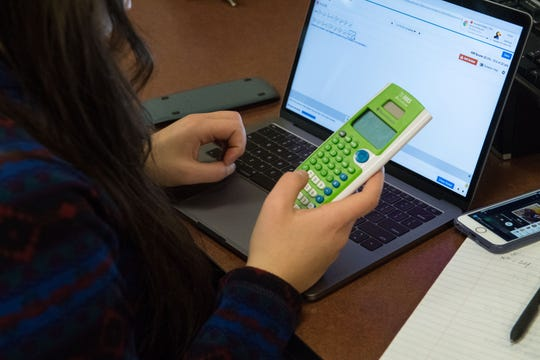 A student works on her math assignment, Tuesday, Feb. 26, 2019 in Sioux Falls, S.D.