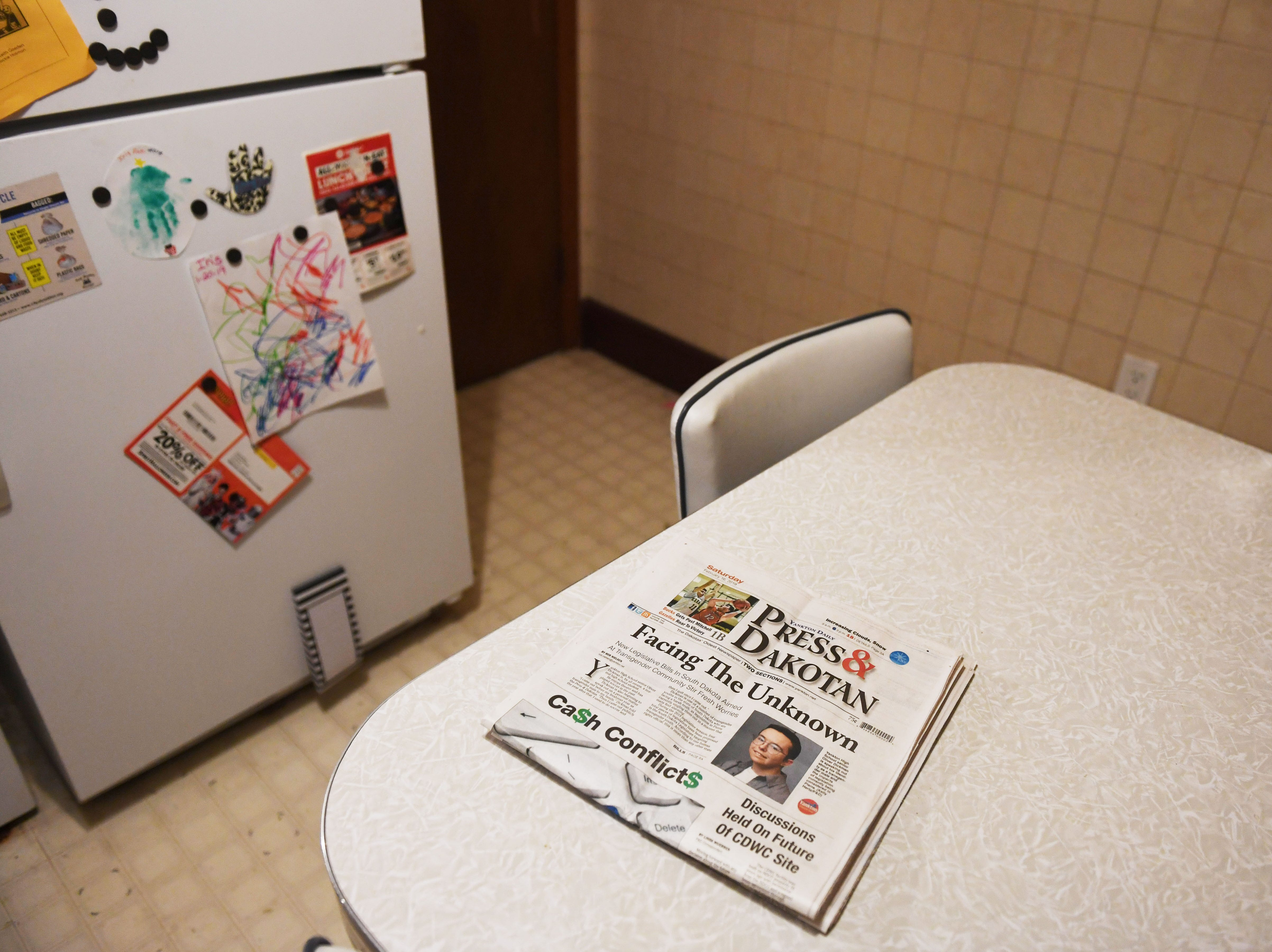 Oliver Dickman has a copy of the Yankton Daily Press & Dakotan, which did a story on Dickman being transgender.