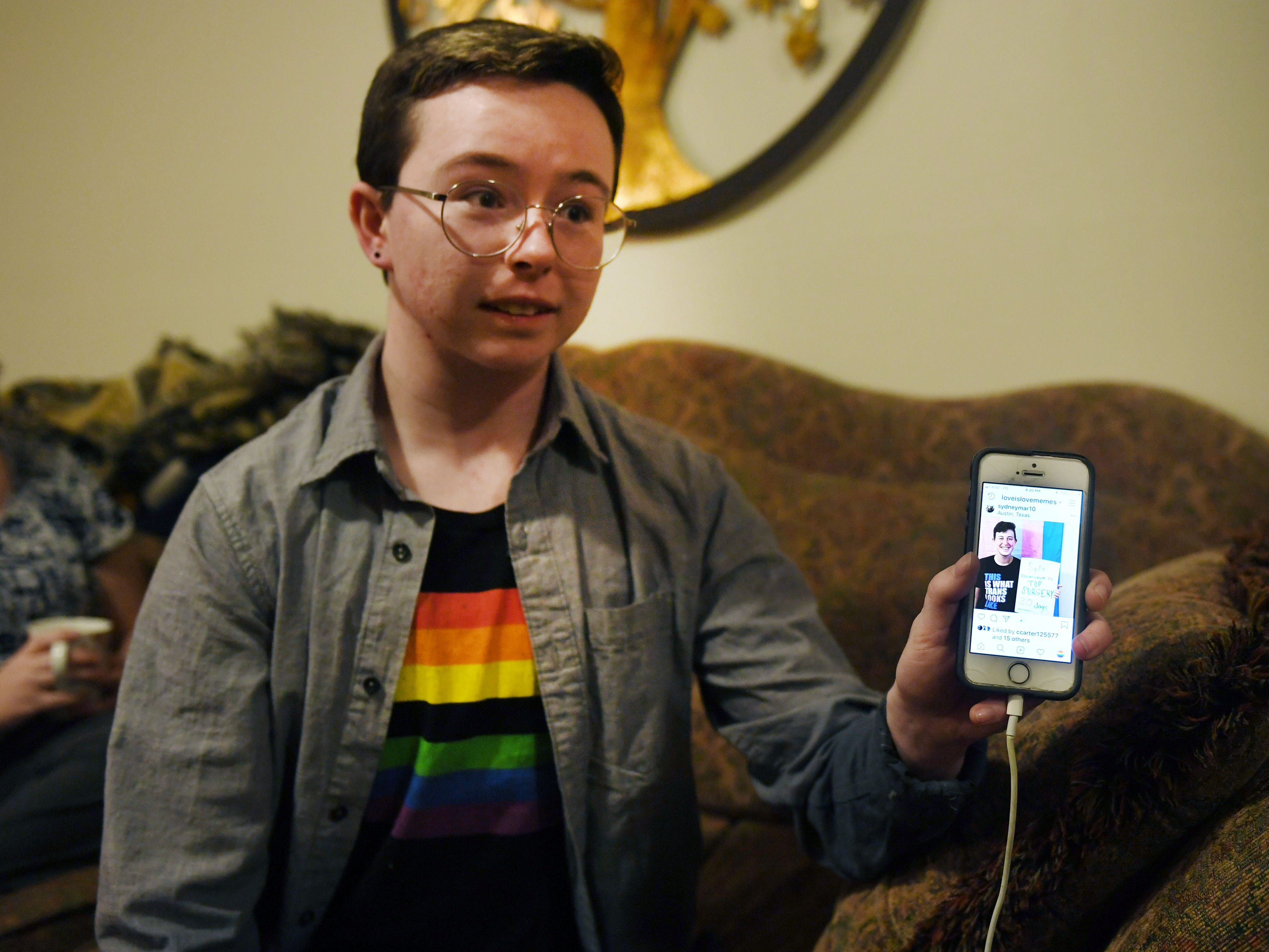 Oliver Dickman shows his Instagram page and transgender art.