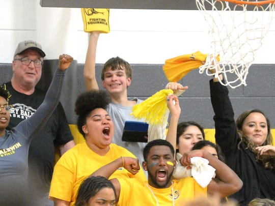 Eric Potter (back, center) cheers for Mary Baldwin during the team's win over North Carolina Wesleyan on February 13 at the school's home gym, the PAC.