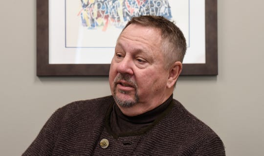 Dr. Ken Holmen, CEO of CentraCare Health, discusses the homelessness problem in Central Minnesota in his office at St. Cloud Hospital Monday, Feb. 25. Holmen will sing in a March 3 concert to benefit United Way of Central Minnesota's homelessness prevention efforts.