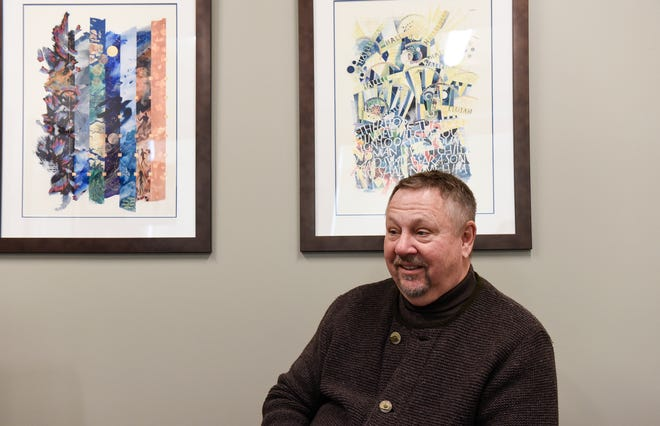 Dr. Ken Holmen talks about his 30 years singing in the National Lutheran Choir in his office at St. Cloud Hospital, Monday, Feb. 25.
