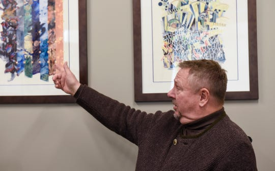 Dr. Ken Holmen, CEO of CentraCare Health, explains the illustrated scripture that hangs in his office at St. Cloud Hospital on Monday, Feb. 25. Holmen is a lifelong Lutheran and has sung in the National Lutheran Choir for 30 years.