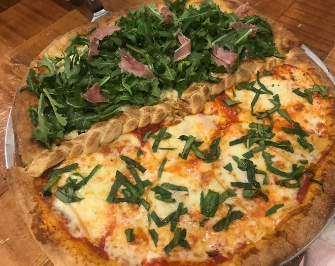 A pizza at 700 Degree Artisan Pizza, half Quattro Formaggio and half Arugula Bianca.