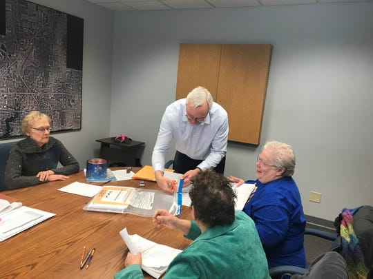 Stevens Point City Clerk Paul Piotrowski unseals the bag containing votes cast during February's nonpartisan primary election for the city's lone primary race in District 9. Challenger Brian Beaulieu requested a hand recount after losing by one to Incumbent Mary McComb. The Tuesday recount changed no votes.