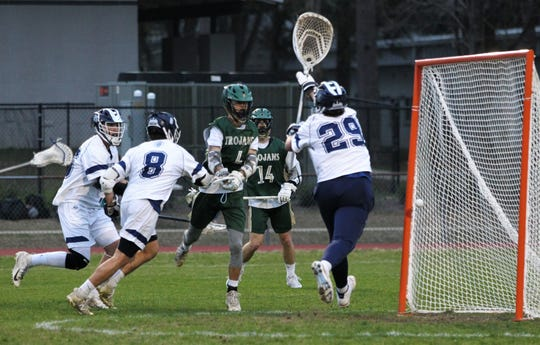 Lincoln's Bryce Correa gets a shot off for a goal as Maclay's lacrosse team beat Lincoln on Feb. 19, 2019.
