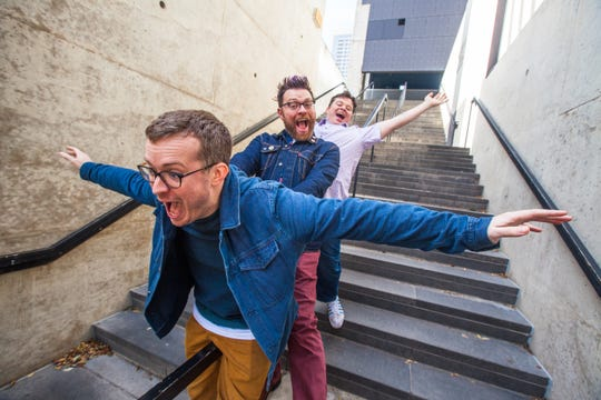 Griffin McElroy (front) has multiple comedy podcasts with his brothers Travis (middle) and Justin (back).
