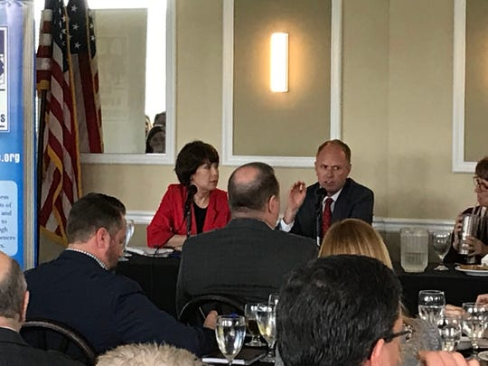 Gwen Graham, left, and Bryan Koon talk with NEBA Tuesday at the Capital City Country Club