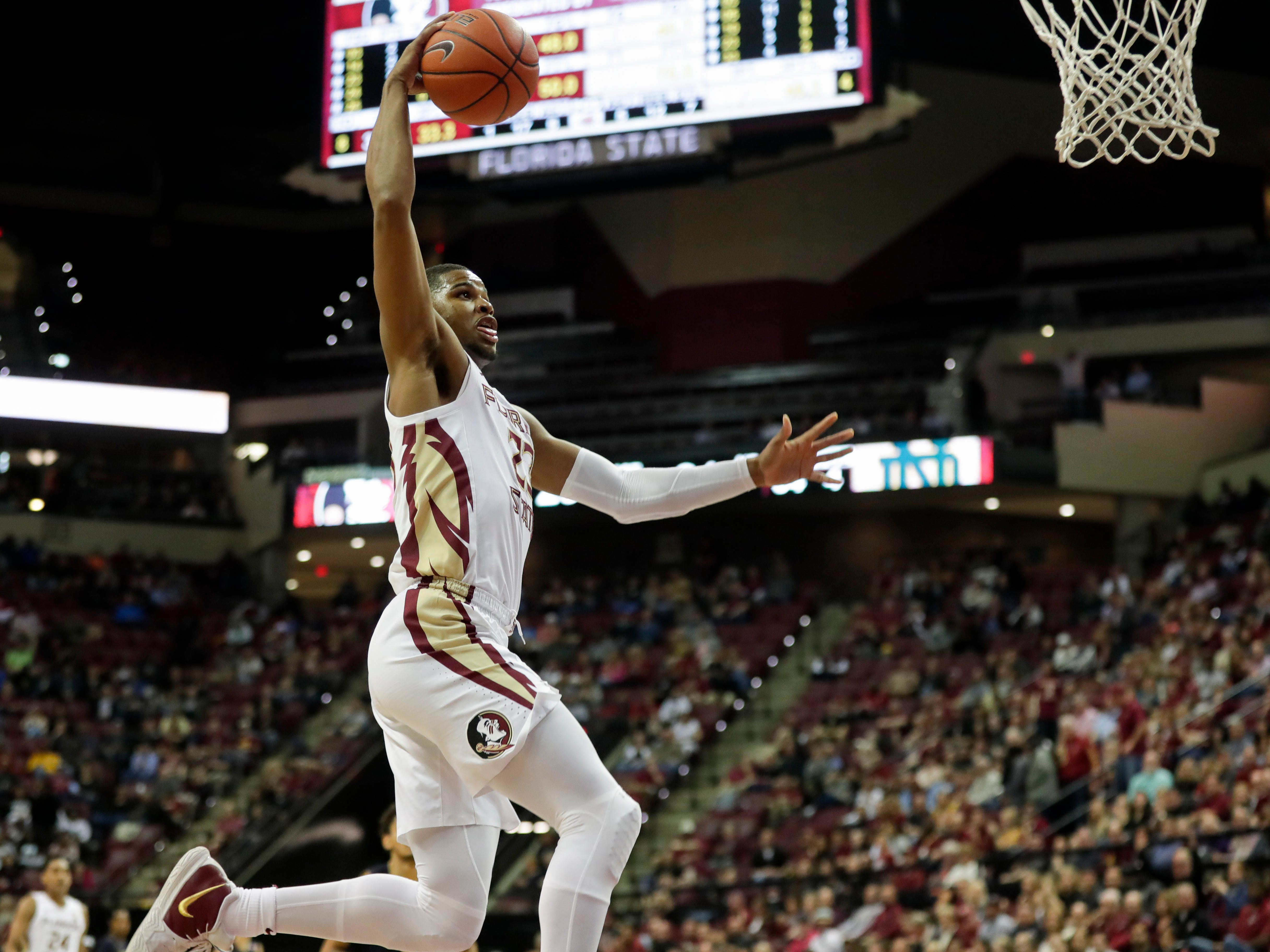 Florida State Seminoles guard M.J. Walker (23) goes up for a dunk during a game between FSU and Notre Dame at the Donald L. Tucker Civic Center Monday, Feb. 25, 2019.