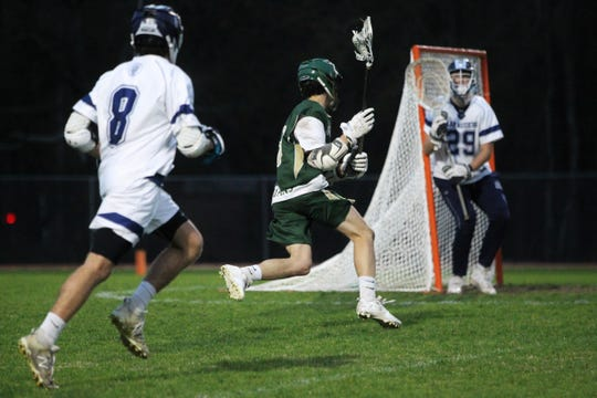 Lincoln's Caleb Gehres makes a move towards goal as Maclay's lacrosse team beat Lincoln on Feb. 19, 2019.