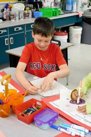 Tucker Raulerson enjoys the drawing station and being challenged to solve problems creatively.