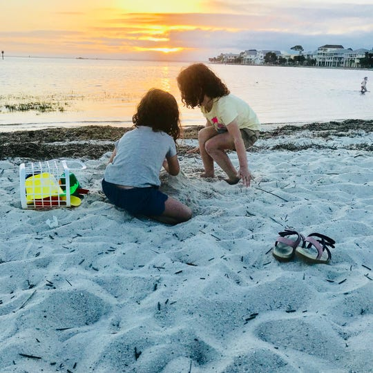 Apollonia and Viv Acevedo play in the sand at Shell Point.
