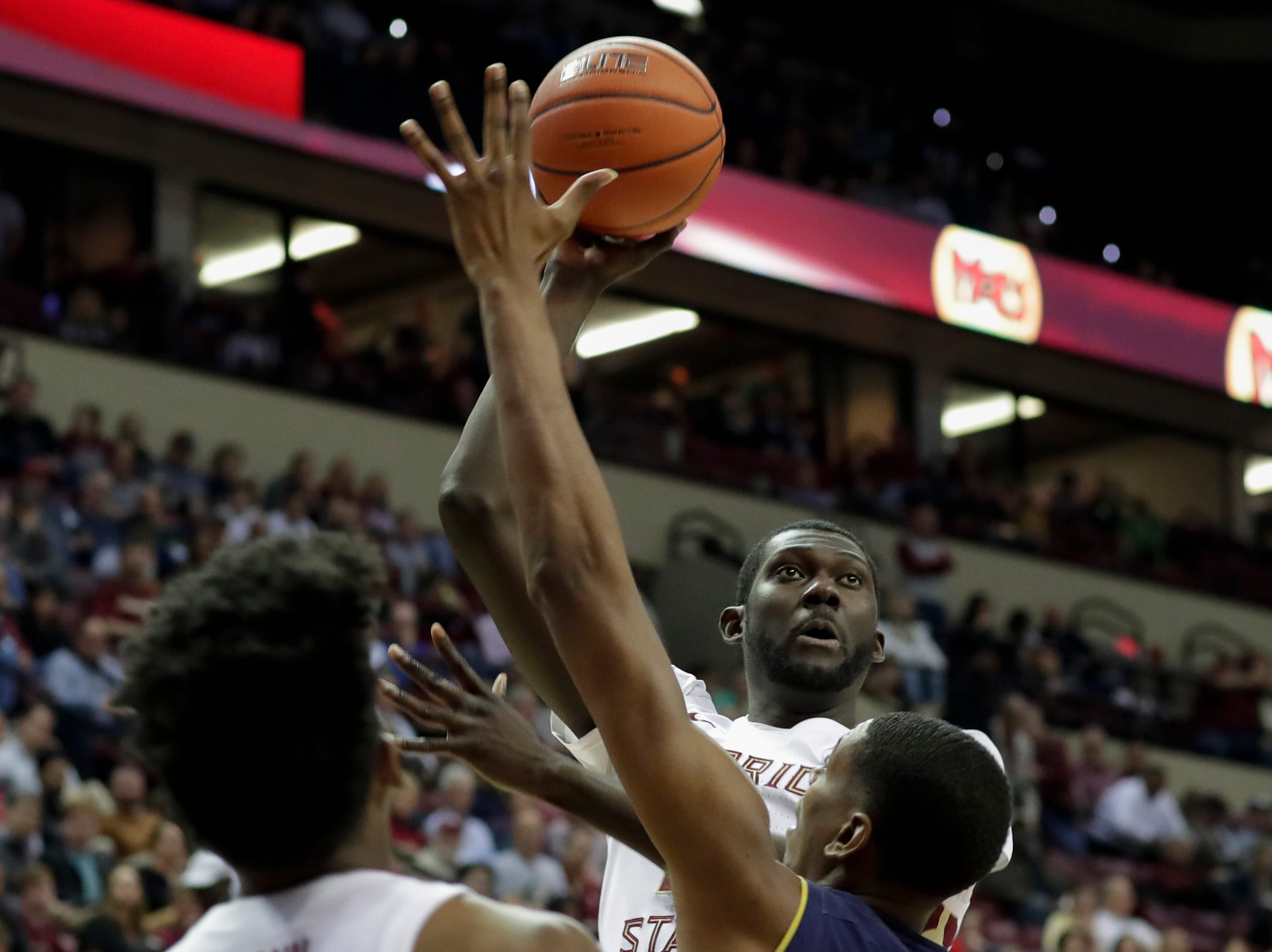 Florida State Seminoles center Christ Koumadje (21) shoots during a game between FSU and Notre Dame at the Donald L. Tucker Civic Center Monday, Feb. 25, 2019.