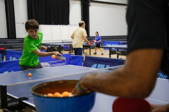 Lucas Mauch, 14, practices his shot during a table tennis lesson with Tilden Corbett at Northside Recreational Center Wednesday, Feb. 20, 2019.