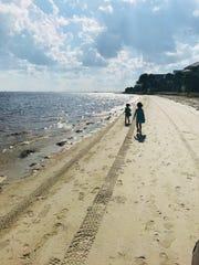 Apollonia and Viv Acevedo walk along the beach at Shell Point.