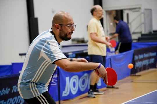 Mark Sidhom hits a backhand during a table tennis match against Ron Cummings at Northside Recreational Center Wednesday, Feb. 20, 2019.