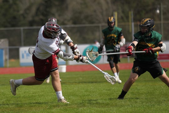 Chiles' Trent Fewox fires a shot for a goal as the Timberwolves' lacrosse team beat Pensacola Catholic on Feb. 23, 2019.
