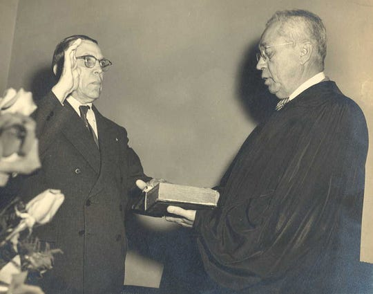 James Vocelle being sworn in as director of the Florida Beverage Department by Supreme Court Justice Elywn Thomas in 1945.