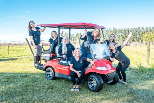 Little Birthday Angels is raffling off this golf cart at its April 6 fundraiser at Summer Crush Winery. Pictured are, from left, Amanda Byford, Heather Burns, Holly Martel, Lynn Campbell, Angel Pietsch, Emilee Moore, and Pudgie Delohery.