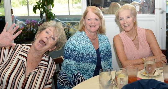Doris Crum, left, Sharon Daniel and Brenda Ayer at the St. Lucie West Garden Club luncheon and fashion show.