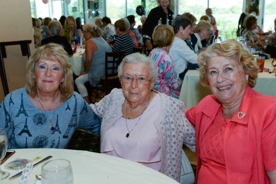Judy Spellman, left, Alice Jordan and Brigette Picardi at the St. Lucie West Garden Club luncheon and fashion show.
