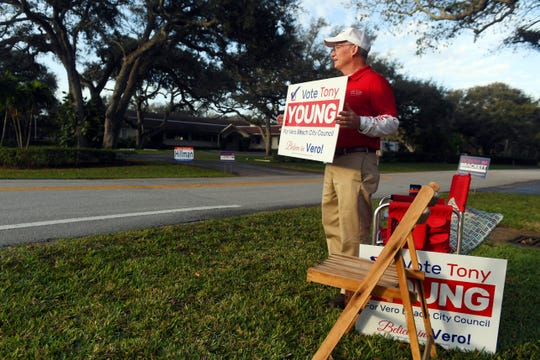 Tony Young, candidate for re-election in the Vero Beach City Council race, holds a campaign sign early Tuesday, Feb. 26, 2019 while standing in front of a polling place at Christ By the Sea United Methodist Church in Vero Beach. The city is holding another council election after two of the candidates, Linda Hillman and Brian Heady, were improperly disqualified from the November race.