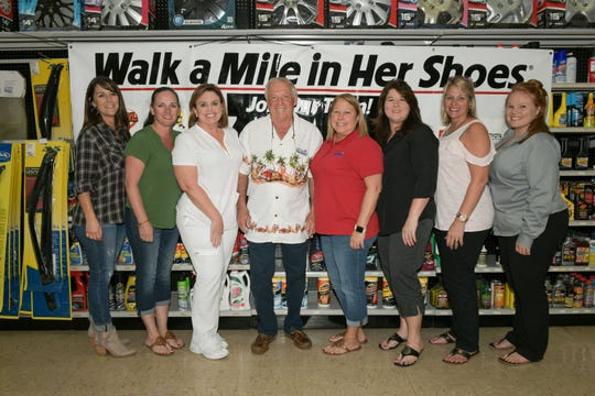 Aimee Long, left, Stacy Schwerer, Denise Helms, Joey Miller, Kelly Miller, Christy Price, Jennifer Clanton and Sydney Albritton at the St. Lucie Battery & Tire Sexy Leg Challenge for SafeSpace.