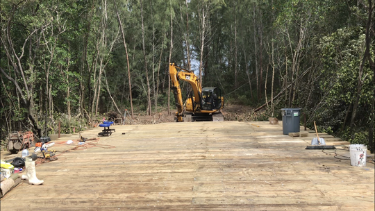 As seen Feb. 26, 2018, a  bridge being built from State Road A1A to a proposed oceanfront housing project on Hutchinson Island in St. Lucie County has cut through a mangrove wetland to a stand of invasive Australian pine trees where the houses will be constructed.