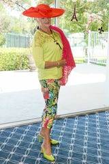 Uta McFadden struts a lovely Patchington ensemble at the St. Lucie West Garden Club luncheon and fashion show.