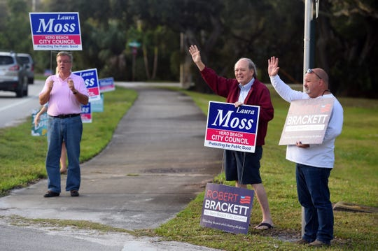 Candidates and supporters waive to motorists on Tuesday, Feb. 26, 2019 outside a polling place at Christ By the Sea Methodist Church in Vero Beach as the city holds an election for the city council. The city is holding another council election after two of the candidates, Linda Hillman and Brian Heady, were improperly disqualified from the November race.