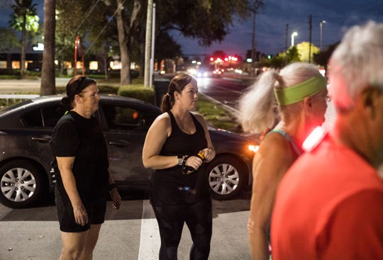 "Heather Coleman (center), of Stuart, and Tammy Fuss (left), of Port St. Lucie, listen to pace group leader Jon Blakeslee after meeting at Fleet Feet in Stuart on Feb. 19, 2019, to train for the upcoming Marathon of the Treasure Coast. ""They have really made me a stronger runner, more competitive, and I just love having them on my side ... knowing that I have someone there,"" Coleman said about Fuss and Blakeslee."