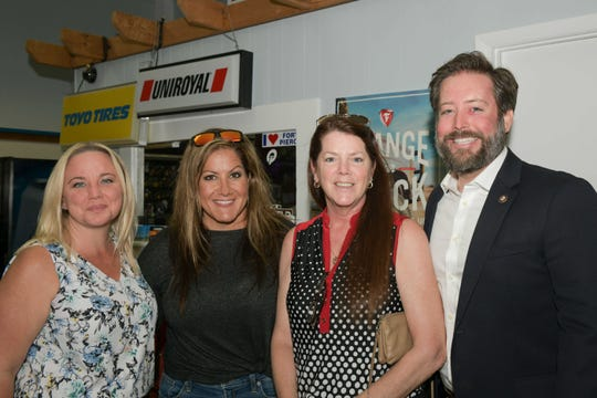 Jenn Dubey, left, Lynette Marraffa, Maddie Williams and James Taylor support the St. Lucie Battery & Tire Sexy Leg Challenge for SafeSpace.
