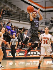 Moorpark College's Breanna Calhoun soars to the basket against Ventura College last Friday night. Calhoun scored 23 points in a 72-39 victory.