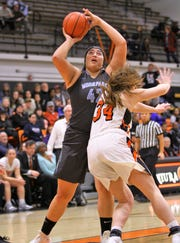 Moorpark College's Barbara Rangel takes a shot against Ventura College last Friday night. Rangel had 21 points and 16 rebounds in the Raiders' 72-39 victory.