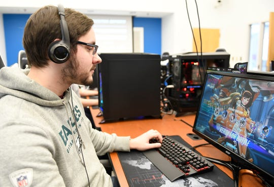 "Brian Kibelstis, 20, of Williamstown, plays ""Overwatch"" in Stockton's eSports facility on Tuesday, Feb. 26, 2019."