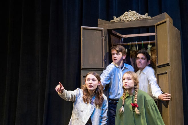 """Zoe Roberts, left, Grayson Miller, Jaymee Meier and Uriah Ibarra rehearse for Enchanted Playhouse's production of """"The Lion, The Witch and the Wardrobe"""" on Friday, February 22, 2019."""