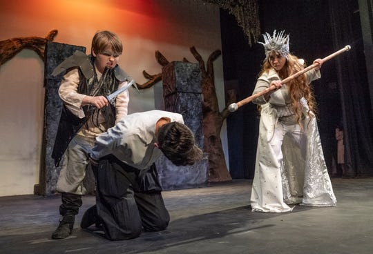 """Joshua Zsido, left, Uriah Ibarra and Lauren Ventura rehearse for Enchanted Playhouse's production of """"The Lion, The Witch and the Wardrobe"""" on Friday, February 22, 2019."""