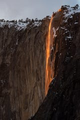 Water glows a bright orange as sun hits Horsetail Fall in Yosemite National Park on Friday, February 22, 2019.