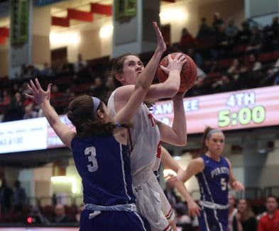 Tappan Zee's Fiona Mullen (4) drives on Pearl River's Mary Windram (3) during the girls class A semifinal game at the Westchester County Center in White Plains on Tuesday, February 26, 2019.