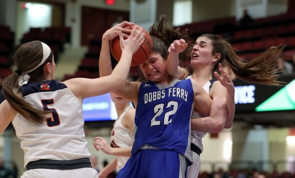 Briarcliff's Julia Barbalato, left, and Alana Lombardi pressure Dobbs Ferry's Julia Schwabe during their Section 1 Class B semifinal at the Westchester County Center Feb. 25, 2019. Briarcliff won 58-54.