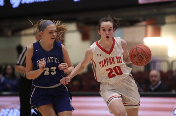 Tappan Zee's Kaleigh Beirne (20) drives past Pearl River's Sarah Lindquist (23) during the girls class A semifinal game at the Westchester County Center in White Plains on Tuesday, February 26, 2019.
